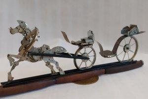 Тачанка з конем з деталей чаов