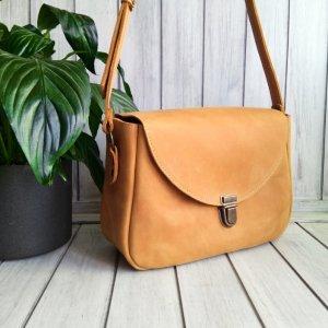 Робота Жіноча шкіряна сумка жовтого кольору.